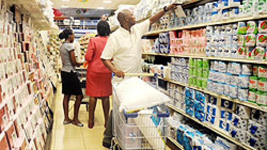 Shoppers in one of Kigali's retail stores. Supermarket owners have decried the poor quality of local products they are supplied with. The New Times / File