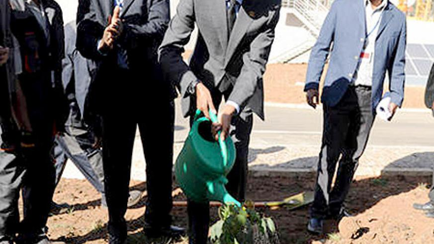 President Kagame waters a tree which he planted in memory of the late Prof. Wangari Maathai, a renowned Kenyan environmentalist, at the newly constructed African Union Conference Centre in Addis Ababa, Ethiopia. The New Times/ Village Urugwiro.