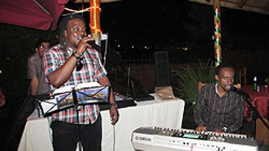 (L) Pianist and music director Didier Kayihura Ntali and Didier Jean Yves Muhawenimana of Kigali Groove Band entertain guests at the event.