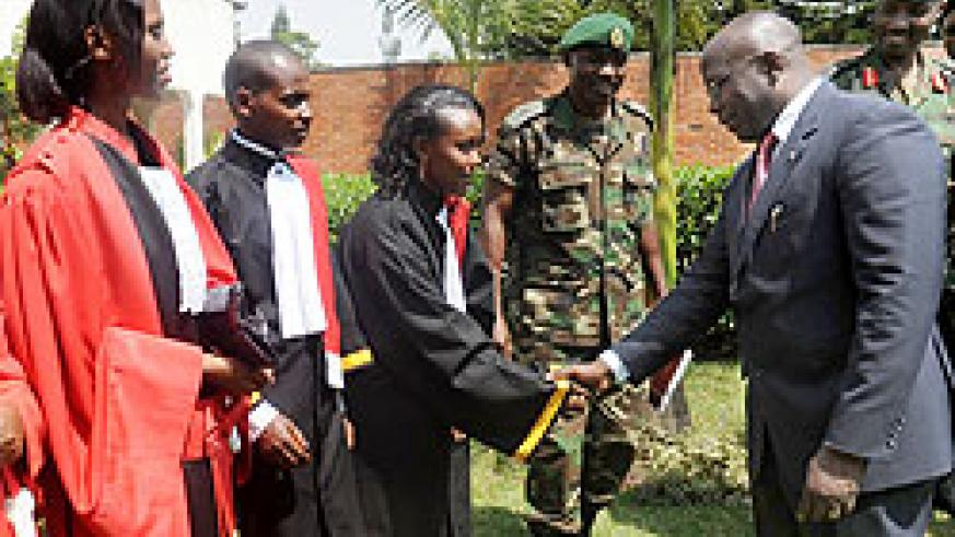 Prime Minister Pierre Damien Habumuremyi (L) congratulates the sworn in prosecutors yesterday The New Times / J. Mbanda