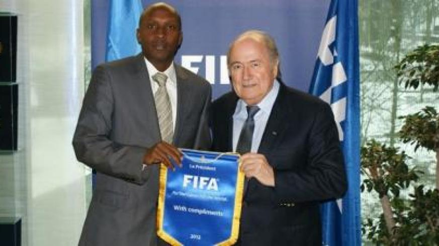 Abega poses for a photo with Fifa president Blatter