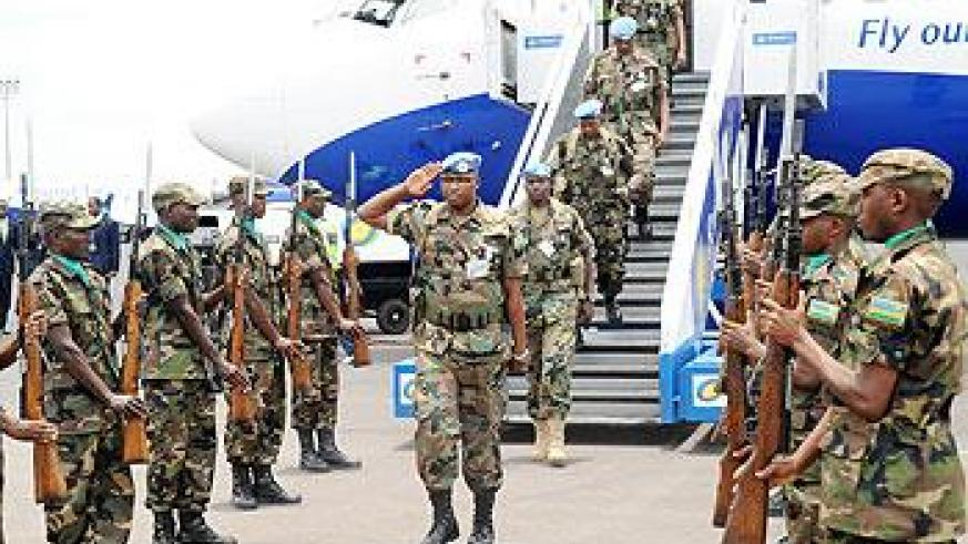 An RDF contigent return home from a peacekeeping mission in Darfur. The liberation struggle was not in vain. The New Times/  File.