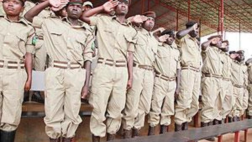 Prison warder at a past function. 100 warders are expected to undergo a two month training programme to sharpen their skills. The New Times / File