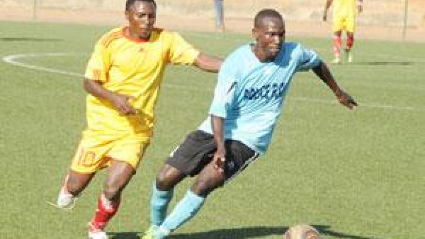 Laudit Mavugo (R) takes on an Etincelles defender in a past league encounter. He scored a brace on Wednesday. The New Times / File