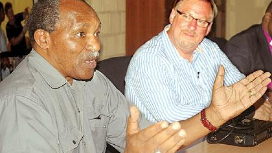 Retired Archbishop Emmanuel Kolini and Pastor Rick Warren of the PEACE Plan project, during a news conference. Some of the issues raised included homosexuality and abortion. The New Times / John Mbanda.