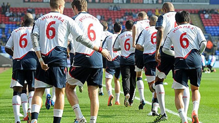 Bolton players warm up for the game wearing 'Muamba 6' jerseys. Net photo.