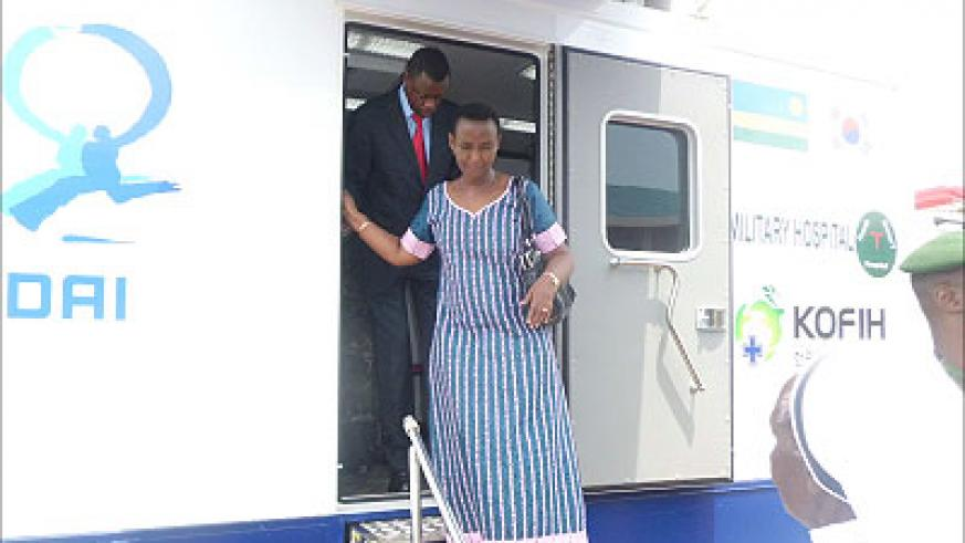 Ministers James Kabarebe and  Aloysea Inyumba, Gender after inspecting the Military Mobile Clinic at Inshuti Zacu Centre.  The Sunday Times / Susan Babujja