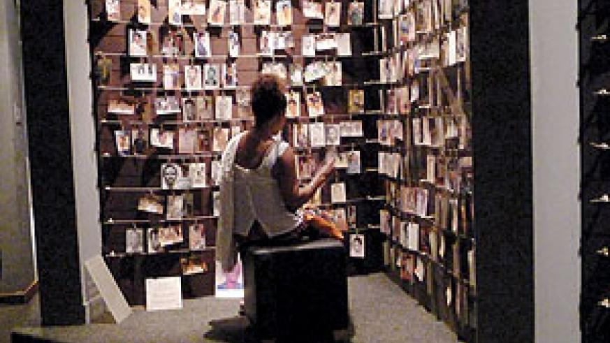 A woman paying her respects at Gisozi Memorial site. Net Photo.