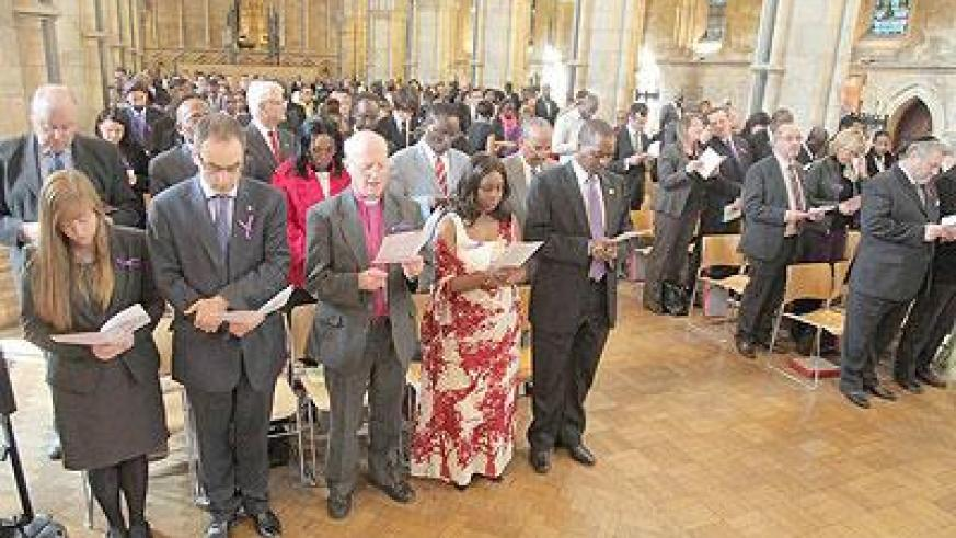 Mourners at a commemoration event in the UK on Wednesday.  The Sunday Times/ Courtesy