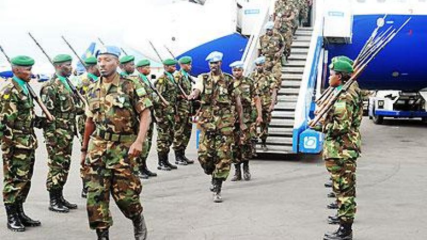 UNAMID peacekeepers on arrival at Kigali International Airport upon completion of their tour of duty in Darfur.  The Sunday Times/ Timothy Kisambira