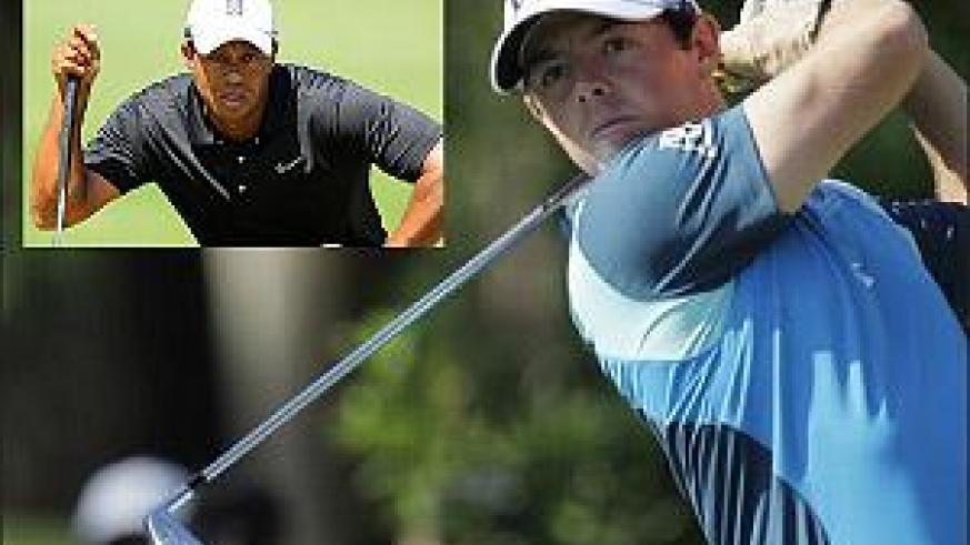 World number one Rory McIlroy suffered more Sawgrass misery, while Tiger Woods, (inset) managed to make the cut. Net photo.