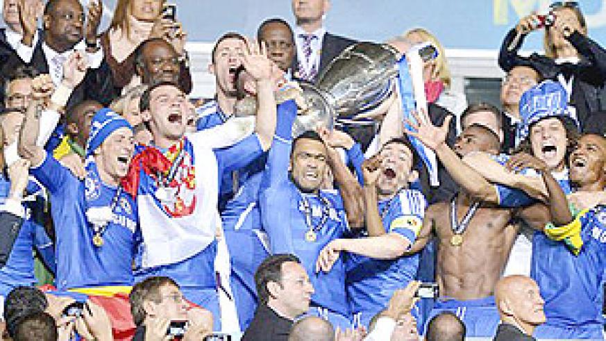 Chealsea players jubilate after winning the Champions League trophy yesterday. Net photo.