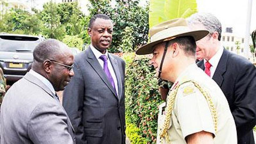 . Prime Minister Dr Pierre Damien Habumuremyi greets Colonel James Davey, Australian Defence Attache, African Union, as Defence Minister General James Kabarebe looks on during a UN Senior Mission Leaders Course held in Kigali on Monday. The Sunday Times /