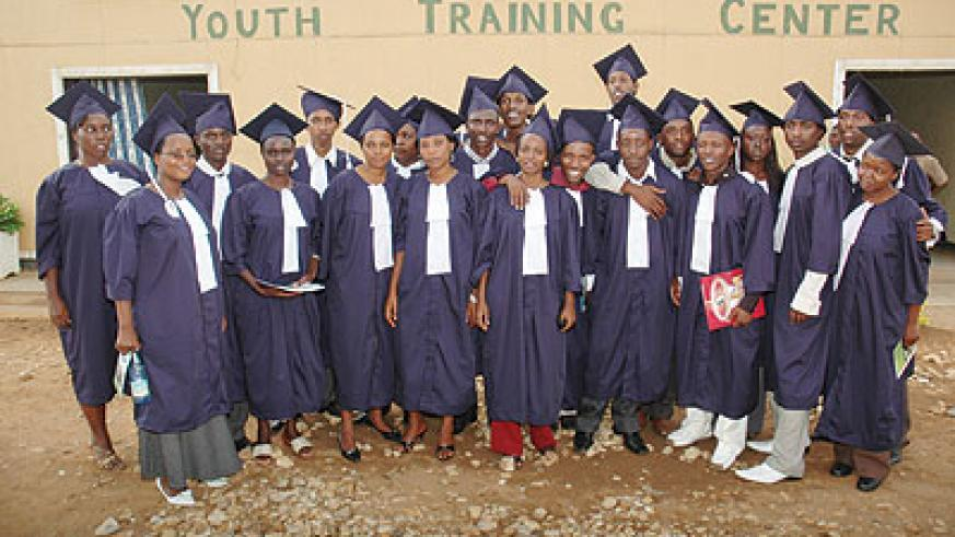 A group of graduates in a past. The New Times / F. Goodman.