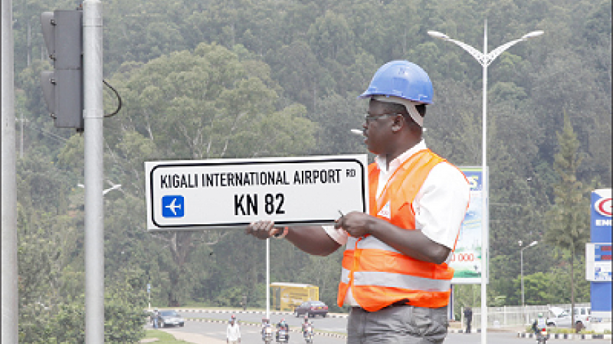 A technician installs new road signs in Kigali City in an exercise to rename all city roads and streets that started last week. The Sunday Times, / T. Kisambira