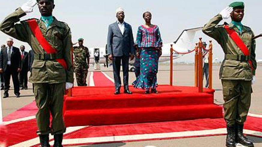 Foreign Affairs Minister Louise Mushikiwabo (R) with Somali President Sheik Shariff Sheik Ahmed (L) at Kigali International Airport, Kanombe on the latter's arrival in the country on Thursday.  The Sunday Times / Timothy Kisambira.