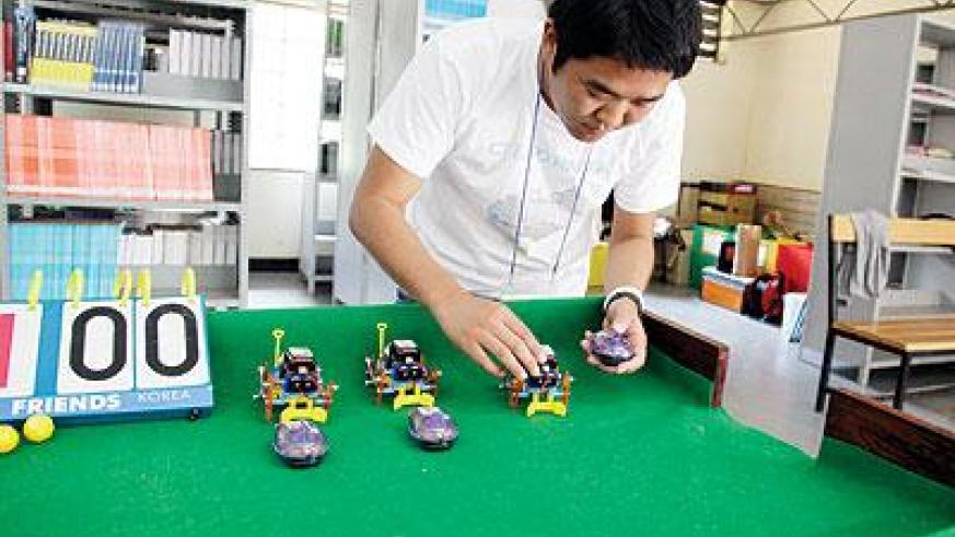 An exhibitor displaying different robots during the ICT Expo on Friday.  The Sunday Times / Timothy Kisambira.