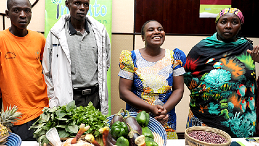 Honoree Nyirahagumimana (2nd right) together with other beneficiaries of imbuto Foundation displaying some of their agricultural produce at the Imbuto's 10th anniversary event. The Sunday Times /Courtesy.