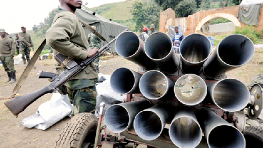M23 fighters show off a captured rocket launcher found on a hill overlooking the border town of Bunagana. The rebels captured the hill and the town from government forces on July 6. Net photo.