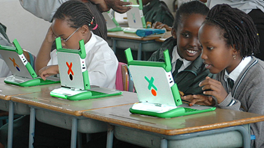 Young school children using lap tops. More children continue to be trained in computer skills. The Sunday Times / File.