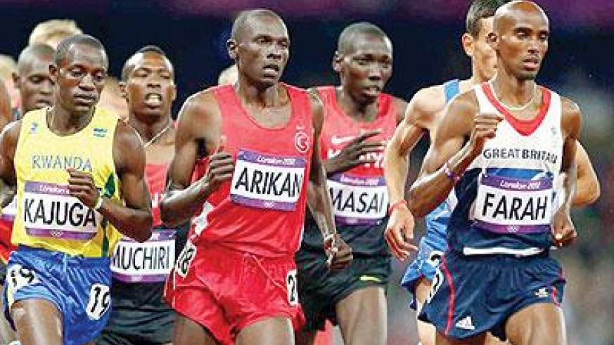 Robert Kajuga (left) competed in the Olympics Games. He finished 12th in the world half marathon yesterday in Bulgaria. Net photo.