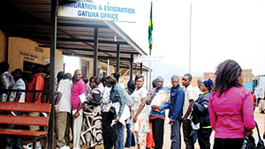 Travellers clear at Gatuna border before crossing out of the country.  The New Times  / J. Mbanda