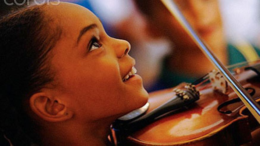 Playing musical instruments at a young age strengthens a child's talent. Net photo.