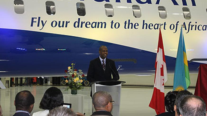 Rwandair's CEO, John Mirenge, addresses guests at handover ceremony of the first CRJ900 held at Bombardier's Mirabel, Québec facility, last month. The New Times / File.