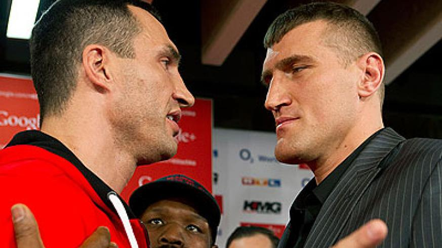 Wladimir (L) Klitschko and Maruisz Wach (R) at their press conference on Wednesday. Net photo.