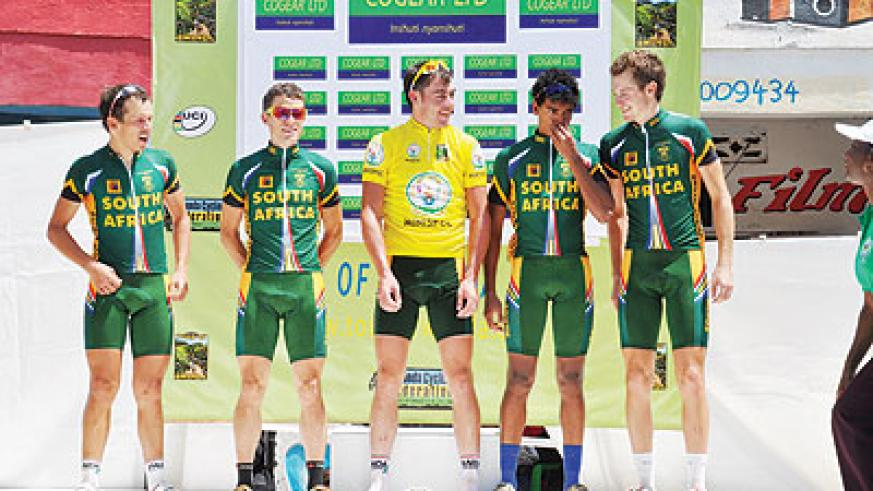 Team South Africa rider Ward Shaun (Yellow Jersey) pose on the podium with team mates yesterday. The New Times/P. Kamasa.