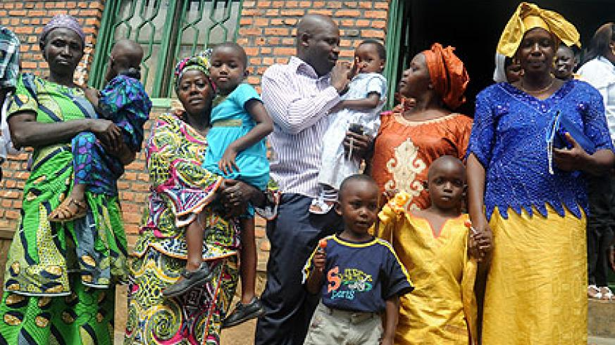 Foster Parents pick children from an orphanage. The government will recruit social workers to help children in their new environment. The New Times / File.