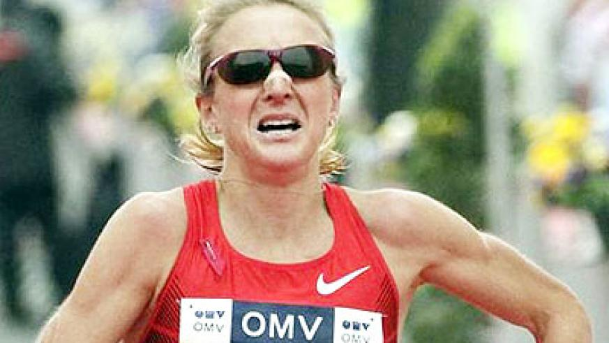 Paula Radcliffe reacts after running the half marathon race during the Vienna City Marathon.