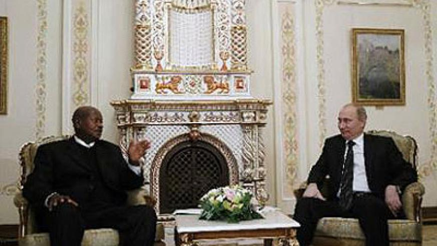 Russian President Vladimir Putin (right) in talks with Uganda's President Yoweri Museveni during their meeting at the Novo-Ogaryovo state residence outside Moscow on December 11, 2012. Net photo.