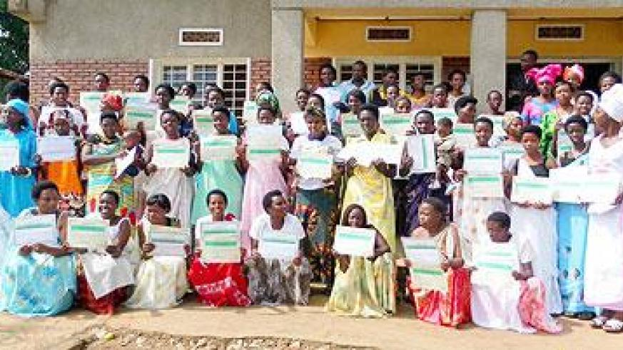 Some of the women who graduated pose with their certificates in a group photograph. The Sunday Times/G. Mugoya.