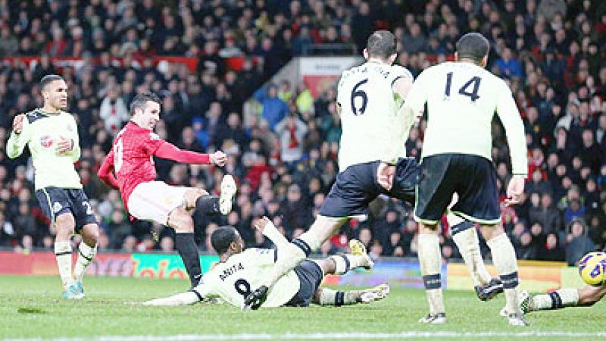 Robin van Persie scores the third goal during the match at Old Trafford yesterday