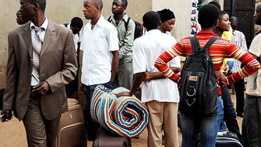 Students await buses in Nyabugogo bus and taxi terminal on their way back school in the past. The New Times/File.