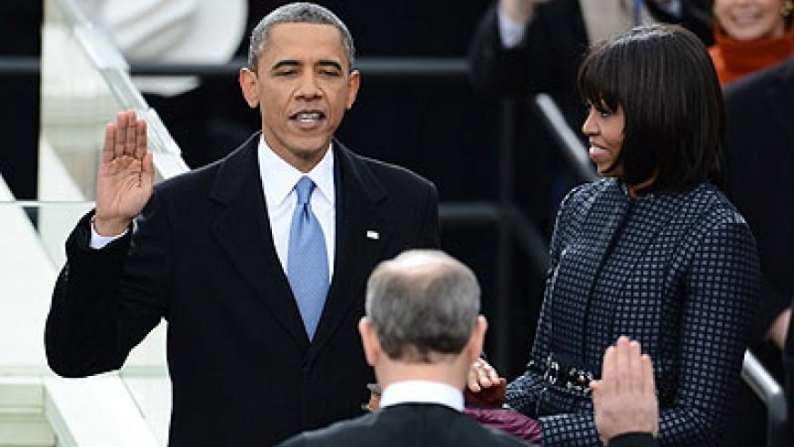 President Obama publicly swears in for second term as US President by Chief Justice John Roberts Jr. Right is First Lady Michelle. Net Photo.