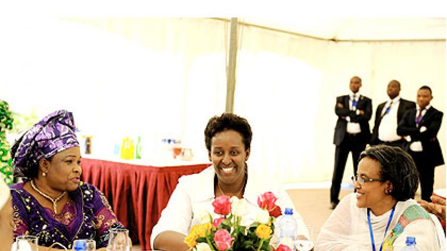 First Lady Jeannette Kagame (C) and her counterparts, Nigeria's Patience Jonathan (L) and Roman Tesfaye of Ethiopia meet at a luncheon in Addis on the sidelines of the ongoing AU Summit.