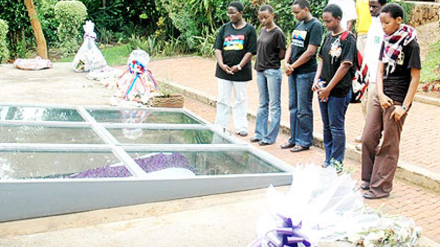 Relatives of victims of the 1994 Genocide against the Tutsi pay tribute at the Genocide Memorial in Kigali recently.  The New Times/ File.