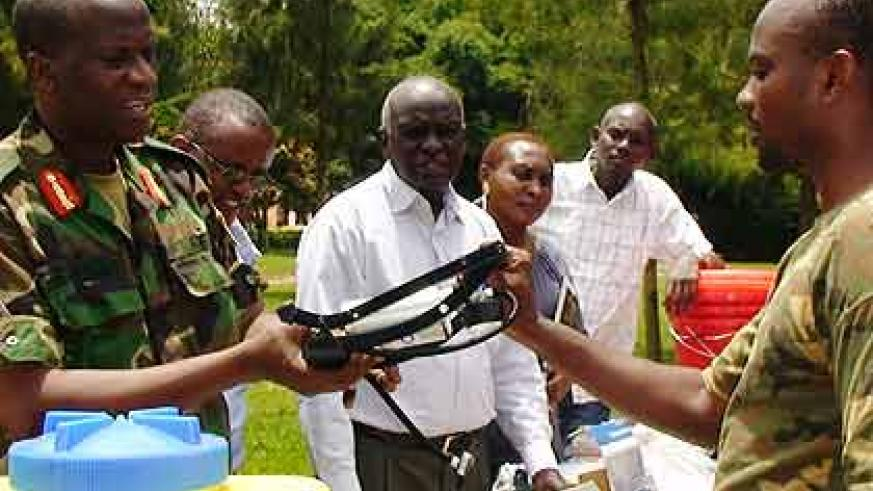 Brig. Gen.  Bagabo gives out a Tool Kit to one of the 7,200  ex-combatants The New Times/ Courtsey
