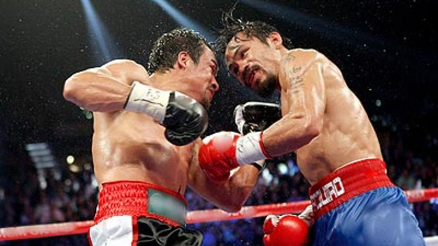 The last fight between Manny Pacquiao (right) and Juan Manuel Marquez (left) was held at the MGM Grand in Las Vegas. Net photo.