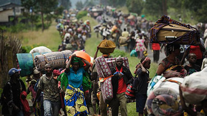 Thousands of Congolese people flee the town of Sake, 26km west of Goma, following fresh fighting in the eastern Democratic Republic of the Congo. The New Times/File.