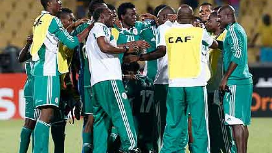 Nigeria's players celebrate winning their 2013 African Nations Cup quarter final match against Ivory Coast. Net photo.
