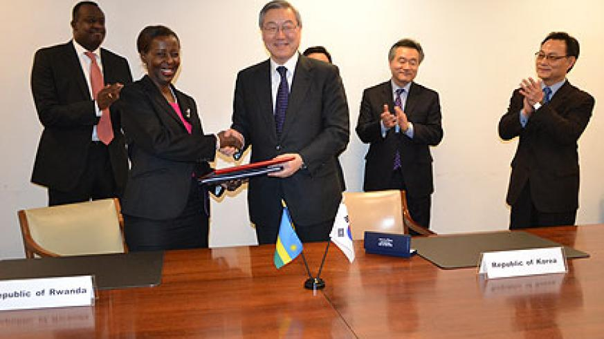 Mushikiwabo and Kim Sung-Hwan, after signing the deal. The New Times/ Courtesy.
