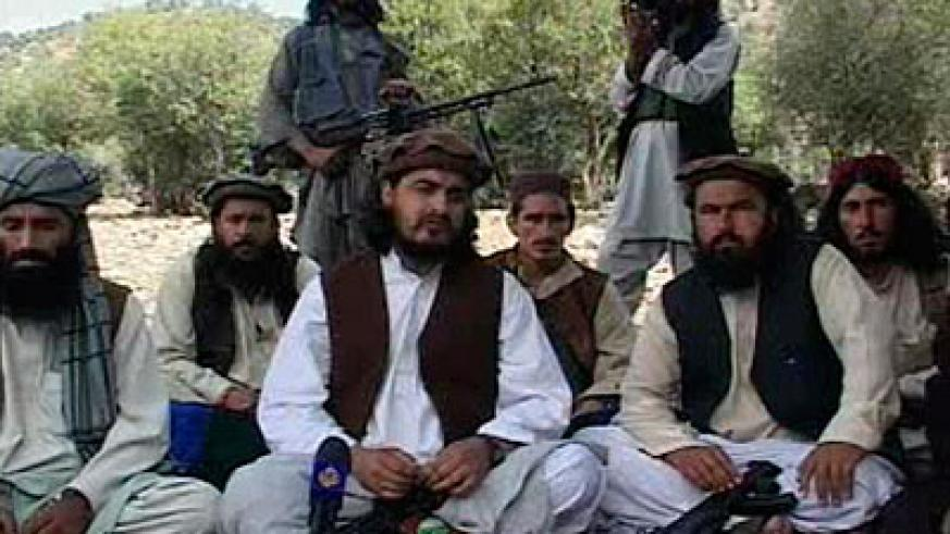 Pakistani Taliban chief Hakimullah Mehsud (centre) sits with other militants in South Waziristan October 4, 2009, in this video frame grab.  Net photo.