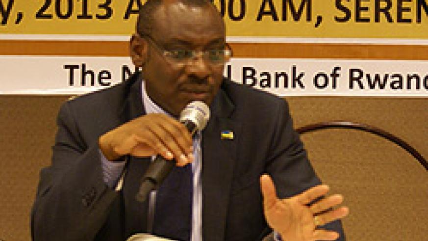 Governor Claver Gatete addresses reporters about the economy's performance in the second half of 2012 on Friday at the Kigali Serena Hotel.. The New Times / File.