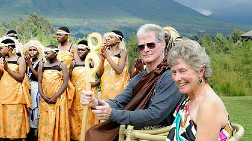 John and Mary Ann McDonald on their 75th tour of Virunga National Park are entertained by traditional troupes.  The New Times/ John Mbanda.
