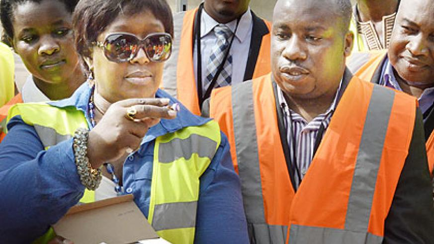 Dr Binagwaho inspects samples of the vaccine in Kigali at the weekend. The New Times/  John Mbanda.