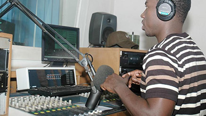 A DJ in a studio of a local radio station. The New Times/ File.