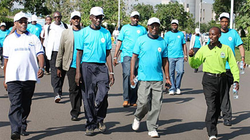 CJ Rugege (C) with other officials during the march. The New Times/ Courtesy